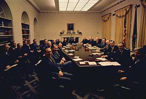 Wally Hickel - The Nixon cabinet poses for a photograph, days after Nixon's inauguration as president. Hickel is slightly left of center.