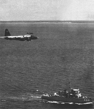 USS Prime (AM-466) - Prime and a SP-2H of VP-4 off Vietnam in 1965.