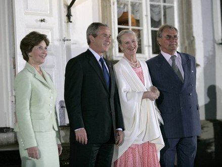 Queen Margrethe II and her husband the Prince Consort welcome President George W. Bush and his wife Laura Bush at Fredensborg Palace, 5 July 2005. Queen Margrethe II and Prince Henrik of Denmark welcome George W. Bush and Laura Bush.jpg