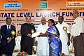 Radha Mohan Singh distributing the certificate of the Pradhanmantri Suraksha Bima Yojana to a beneficiary, in Chennai. The Governor of Tamil Nadu, Dr. K. Rosaiah and the Minister for Electricity, Tamil Nadu (1).jpg
