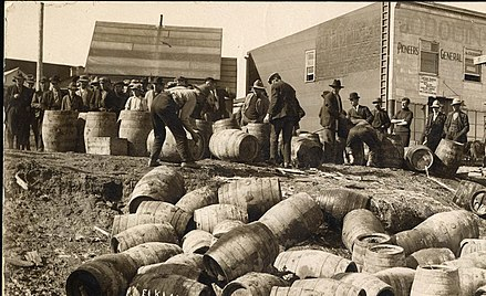Law enforcement confiscate stores of alcohol in Elk Lake in an effort to enforce prohibition. The prohibition measures were introduced in 1916, and were not repealed until 1927. Raid at elk lake.jpg