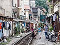 Railway line runs in the center of Hanoi, cutting through streets in the old town district (15683652220).jpg