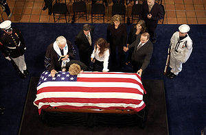 Death and state funeral of Ronald Reagan - Nancy Reagan leans her head on her husband's casket at his presidential library