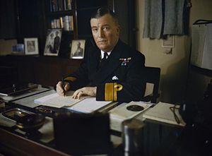 Robert Burnett - Rear Admiral Sir Robert Burnett sitting at his desk on board the HMS Tyne