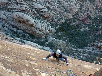 Climber a few pitches up on a multi-pitch climb Red Rocks - Climbing Prince of Darkness - 20.jpg