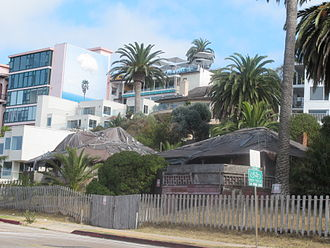 "La Jolla - ""Red Roost"" and ""Red Rest"", two bungalow cottages built in 1894 on the road above La Jolla Cove. In recent years the cottages have been covered in tarpaulins."