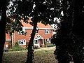 Red brick house hiding behind trees - geograph.org.uk - 552559.jpg