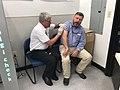 Rick Crawford getting a flu shot.jpg