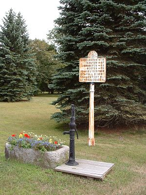 Rochester, Massachusetts - An old road sign and water pump at the Town Common, on Route 105