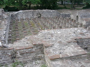 Public bathing - Ruins of a Roman bath in Dion, Greece, showing the under-floor heating system, or hypocaust