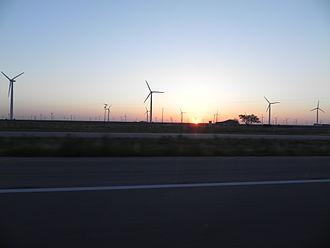 Wind power in Texas - The 781 MW Roscoe Wind Farm at sunrise.