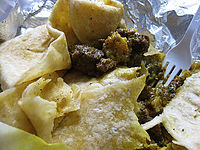 Roti wrap made with curry goat and potatoes 01.jpg