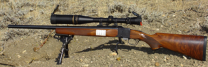 "Varmint rifle - Ruger No. 1 Varmint rifle in .223 Remington. Note the heavy barrel, bipod rest, large telescopic sight, and ""dope"" sheet on the stock for windage"