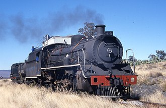 South African Class 19B 4-8-2 - No. 1412 taking water at Blouwater, c. 2001