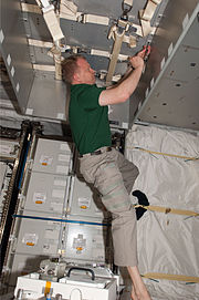 STS-133 ISS-26 Eric Boe works in the newly-installed PMM Leonardo