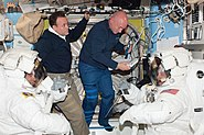 STS-134 EVA4 preparations in the Quest airlock