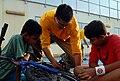 Sailor helps child fix bike DVIDS219406.jpg