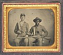 Sergeant A.M. Chandler of the 44th Mississippi Infantry Regiment, Co. F., and Silas Chandler, family slave, with Bowie knives, revolvers, pepper-box, shotgun, and canteen.jpg