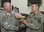 Sgt. Maj. Adams Receives a Fort Suse Coin From His Son DVIDS14925.jpg