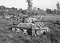 Sherman Firefly awaiting orders to move forward Operation Goodwood July 1944.jpg