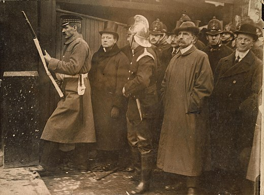 Churchill photographed at the Siege of Sidney Street Siege of Sidney Street – Churchill.jpg