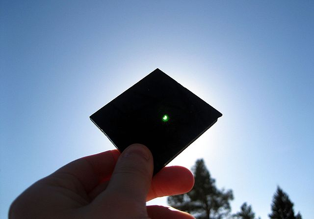Solar eclipse & welding glass 2015-03-20.jpg