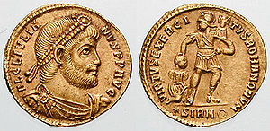 "Julian solidus, c. 361. The reverse depicts an armed Roman soldier bearing a military standard in one hand and subduing a captive with the other, a reference to the military strength of the Roman Empire, and spells out VIRTVS EXERCITVS ROMANORVM, ""the bravery/virtue of the Romans' army"""