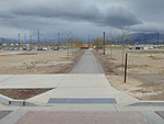 Southwest along walkway to Daybreak Parkway station Park & Ride lot, Apr 16.jpg