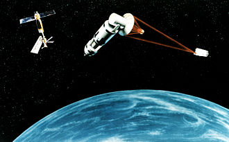 Asteroid impact avoidance - The 1984 Strategic Defense Initiative concept of a generic space based Nuclear reactor pumped laser or a hydrogen fluoride laser satellite, firing on a target, causing a momentum change in the target object by laser ablation. With the proposed Space Station Freedom(ISS) in the background.