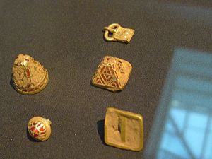 Staffordshire Hoard - Assorted uncleaned gold fittings, three with cloisonné gold and garnet.