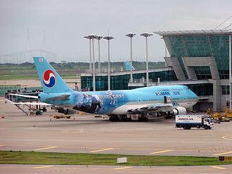 StarCraft II: Wings of Liberty - A Korean Air Boeing 747-400 at Incheon International Airport with an advertisement for StarCraft II painted on the fuselage.  Jim Raynor is prominently displayed on the plane.