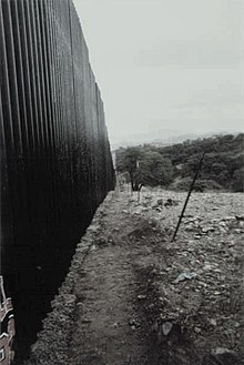 Steel barrier wall near Mariposa port of entry, Nogales, Sonora, Mexico. This view is from Sonora northeast, looking toward Arizona.