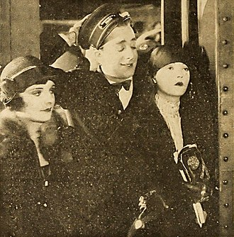 Subway Sadie - A scene from the film, featuring Mulhall and Mackaill. Their successful pairing in Subway Sadie led to them appearing in several other films.