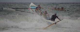 Surfboat - Surf boat passing a breaker.