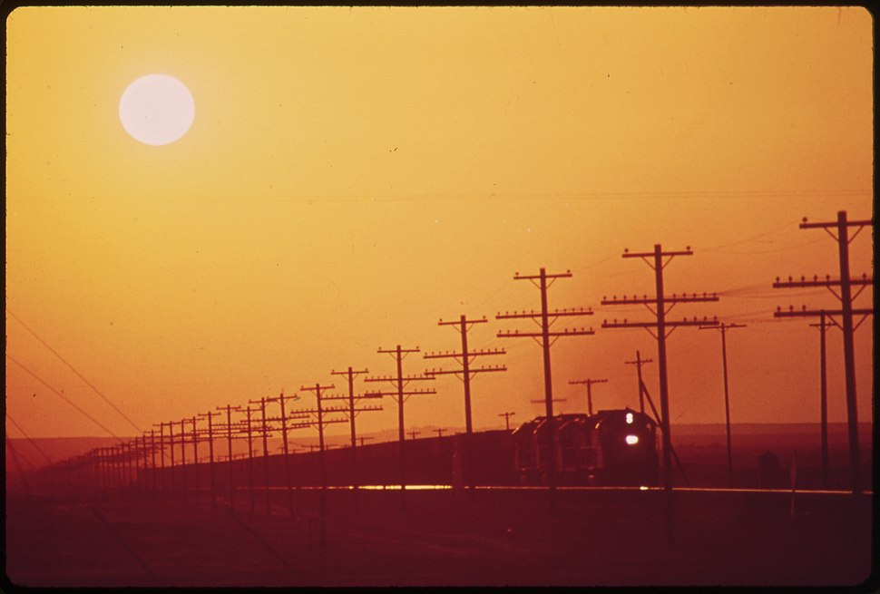 TRANSMISSION LINES AND RAILROAD NEAR SALTON SEA. DISTRICT OF LOS ANGELES SMOG OBSCURES THE SUN - NARA - 547711