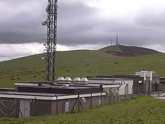 Angus transmitting station - Base of transmitter and surrounding buildings seen close up. Other transmitters situated on adjacent Craigowl Hill can be seen in the distance.