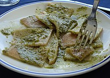 A plate of testaroli with pesto, as served at a trattoria in Pontremoli, Italy