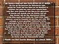 Teufel an der Marienkirche Lübeck, plaquette with its story.jpg