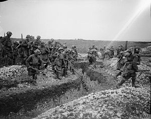51st (Highland) Division - Men of the 1/4th Battalion, Gordon Highlanders crossing a trench, Ribecourt, France, 20 November 1917.