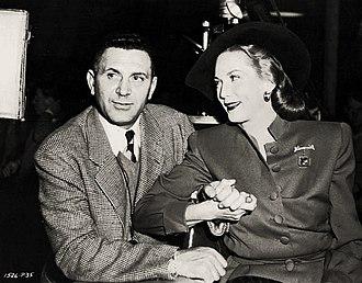 Milton Krasner - Milton R. Krasner (left) and Louise Allbritton on the set of The Egg and I (1947)