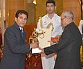 The President, Shri Pranab Mukherjee presenting the Dronacharya Award for the year-2016 to Shri Sagar Mal Dhayal for Boxing, in a glittering ceremony, at Rashtrapati Bhavan, in New Delhi on August 29, 2016.jpg