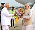 The Prime Minister, Shri Narendra Modi being received by the Governor of Karnataka, Shri Vajubhai Rudabhai Vala, on his arrival, at the HAL airport, Bangalore on September 23, 2014.jpg