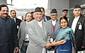 The Prime Minister of Nepal, Shri K.P. Sharma Oli being received by the Union Minister for External Affairs, Smt. Sushma Swaraj on his arrival, at Indira Gandhi International Airport, in New Delhi.jpg