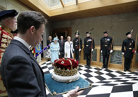 The Crown of Scotland is carried by the Duke of Hamilton as the Queen leaves the Chamber, following the Opening of the fourth Session in July 2011. The Queen at the Scottish Parliament.jpg
