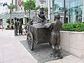 The River Merchants (2003) by Aw Tee Hong, Cavenagh Bridge, Singapore - 20051203.jpg