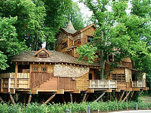 Tree house - Treehouse at The Alnwick Gardens in the United Kingdom, with walkways through the tree canopy
