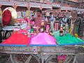 The colors of life.... a festival of colors that call Holi and a wander selling talcum powder colors on eve on holi. - panoramio.jpg