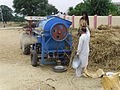 Thresher during wheat season in Islamabad Village.JPG