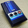 Tomy Cosmic Combat by Tomytronics, Made in Japan, Copyright 1980 (LED Handheld Electronic Game).jpg