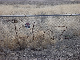 Topaz War Relocation Center - Sign, written in barbed wire, located at the memorial site at Topaz War Relocation Center.